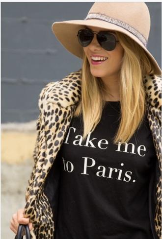 hat black top coat animal print quote on it