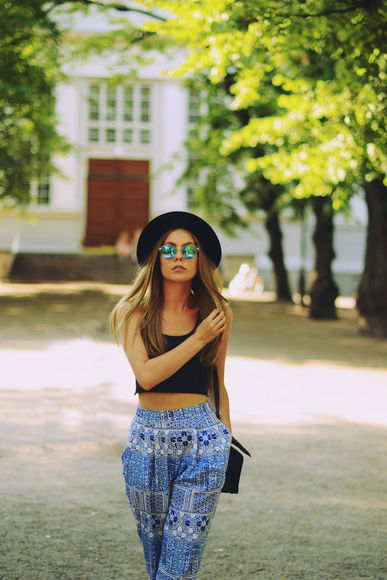 hat the next episode sunglasses top shoes bag blogger mirrored sunglasses round sunglasses summer outfits harem pants crop tops black crop top black top monki h&m hobo hipster