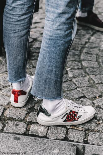 shoes tumblr fashion week 2017 streetstyle sneakers white sneakers low top sneakers socks denim jeans blue jeans cropped jeans gucci gucci shoes