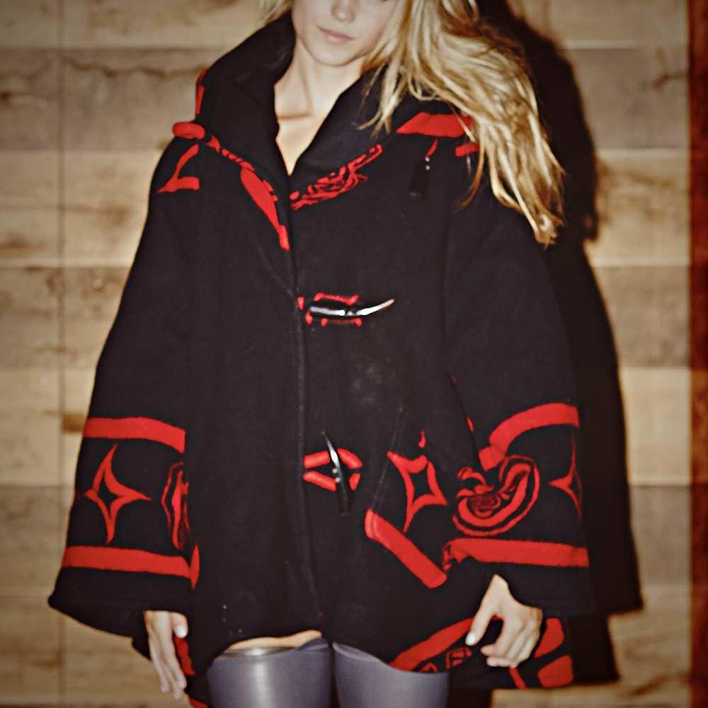 Reverse raven trench cloak
