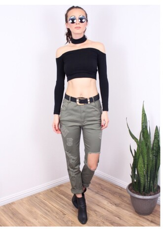 kylie jenner ripped cargo pants black crop top long sleeves off the shoulder crop tops black top black boots