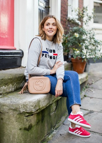 blogger sweater t-shirt jeans bag jewels fall outfits gucci bag sneakers grey sweater