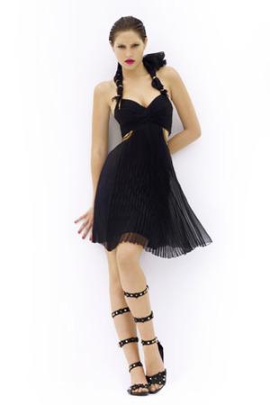 Celebrities who wear louis vuitton resort 2010 black dress