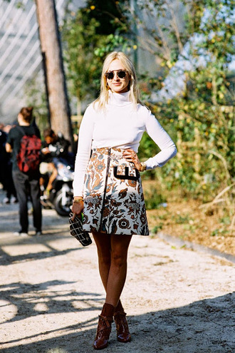 vanessa jackman blogger skirt sweater pattern turtleneck patterned skirt zipped skirt zip-up skirt floral skirt printed  skirt white top long sleeves patent leather shoes brown shoes brown boots pouch printed pouch sunglasses fall outfits patent boots white turtleneck top