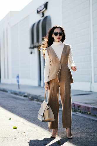 hallie daily blogger bag winter outfits camel turtleneck cat eye nude high heels