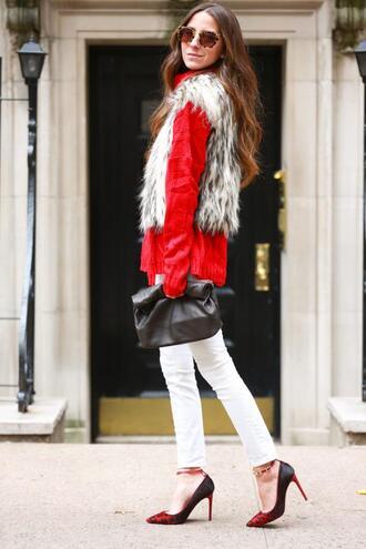 something navy blogger sunglasses blouse stilettos white jeans pouch faux fur sweater jeans shoes bag jacket printed fur vest