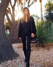 shoes,boots,cowboy boots,black boots,black jeans,black blouse,v neck,shoulder bag