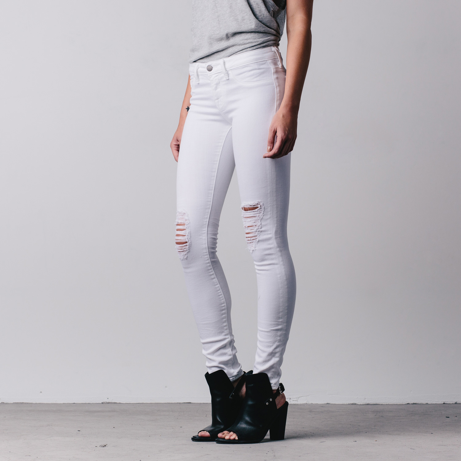 Ripped Mid Rise Skinny Jeans In White | DSTLD Luxury Jeans ...