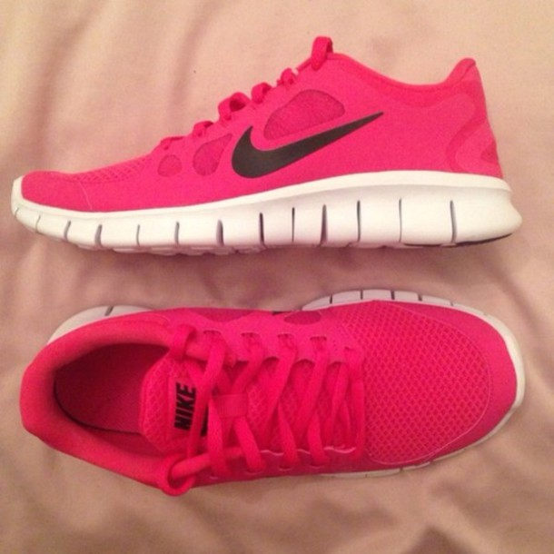 black nike trainers with pink tick