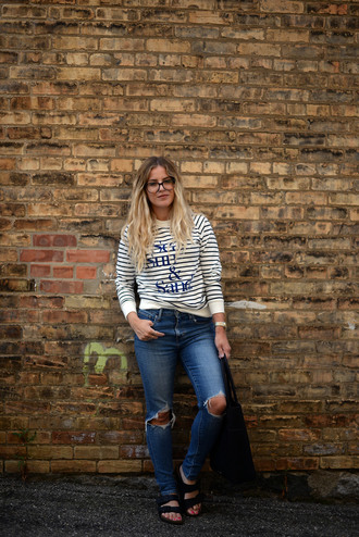 blonde bedhead blogger sweater jeans jewels bag stripes ripped jeans flats quote on it top striped top striped sweater glasses nerd glasses blue jeans slide shoes black slides