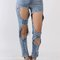 Large holes distressed jeans
