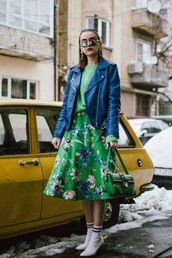 skirt,floral skirt,green skirt,midi skirt,sweater,green sweater,jacket,sunglasses,boots,white boots