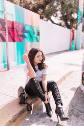jeans,tumblr,black jeans,lace up,t-shirt,white t-shirt,clear lens sunglasses,sunglasses,boots,ankle boots,bag,black bag,jewels,shoes