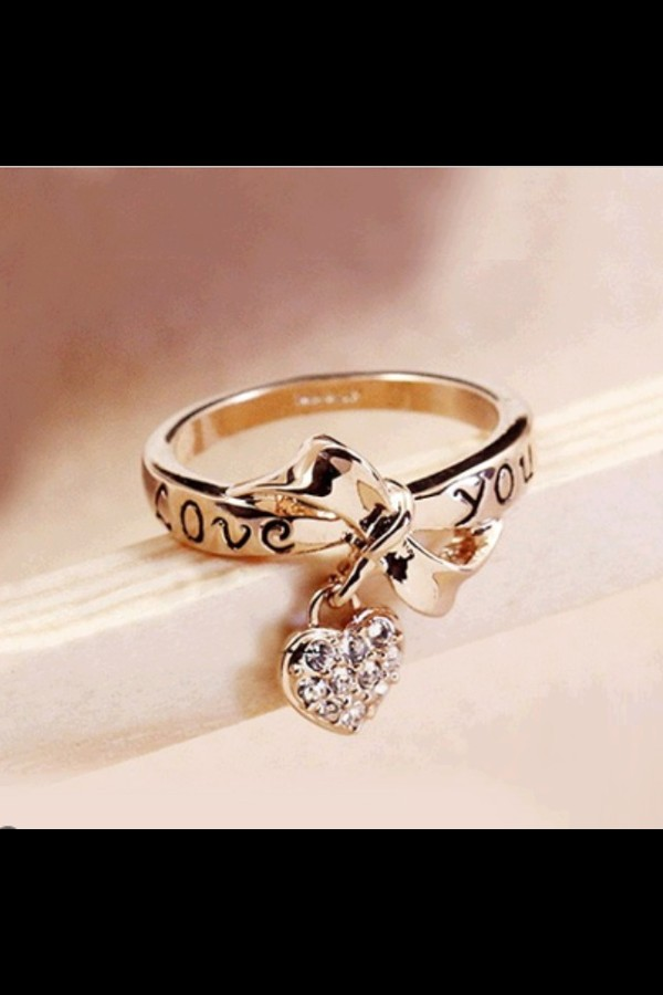 jewels ring heart bows love ring beautiful love you internet bling love love you ring gold ring diamonds i love you ring silver ring valentines day gift idea gold ring gold ring bow ring heart jewelry bow rings silver heart i love you ribbon