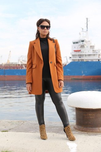 shoes printed boots printed ankle boots ankle boots animal print leopard print high heels boots leggings black leggings top black top turtleneck coat orange coat sunglasses black sunglasses fall outfits