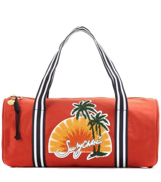 bag see by chloé chloe mytheresa gym gym bag red bag duffel bag