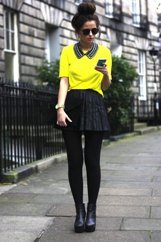 top neon yellow pop of color pleated skirt short statement necklace