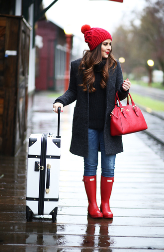 dress corilynn blogger coat sweater jeans hat shoes bag make-up black cable knit sweater cable knit black sweater beanie pom pom beanie red bag denim blue jeans wellies red boots winter outfits winter look