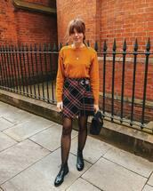 skirt,mini skirt,asymmetrical skirt,wrap skirt,plaid skirt,boots,black boots,tights,handbag,sweater,knitted sweater,chain necklace