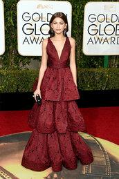 dress,gown,burgundy,burgundy dress,plunge dress,zendaya,red carpet dress,Golden Globes 2016,clutch