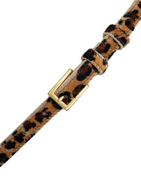 Black & Brown   Cinturón estrecho de pelo de poni de Black & Brown en ASOS