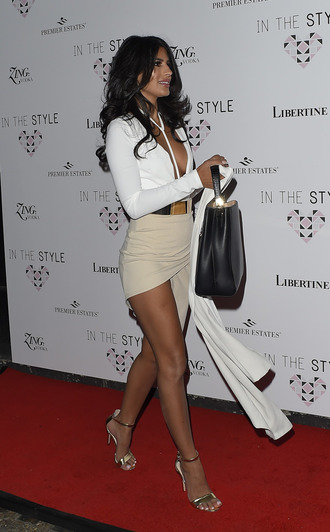 sandals high heel sandals gold sandals skirt wrap skirt nude skirt sexy skirt plunge v neck white top long sleeves belt gold belt bag black bag coat white coat red carpet