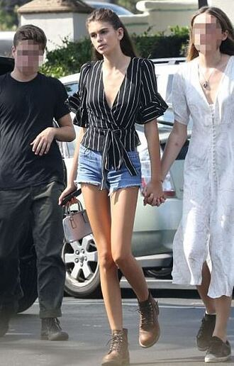 top streetstyle kaia gerber model off-duty boots shorts denim shorts plunge v neck wrap top stripes