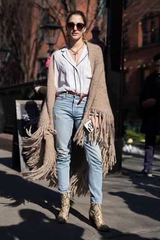 scarf nyfw 2017 fashion week 2017 fashion week streetstyle blanket scarf fringes shirt white shirt jeans denim blue jeans boots printed boots sunglasses necklace jewels jewelry