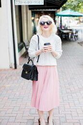 poor little it girl,blogger,sweater,skirt,white sweater,black bag,pink skirt,pleated skirt,light pink,white cable knit sweater,black sunglasses,midi skirt,shoulder bag