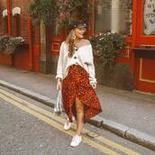 skirt,midi skirt,wrap skirt,asymmetrical skirt,white sneakers,oversized sweater,button up,handbag,earrings,fisherman cap