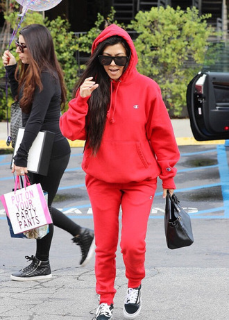 pants sweatpants sweatshirt hoodie red kourtney kardashian sneakers streetstyle sunglasses