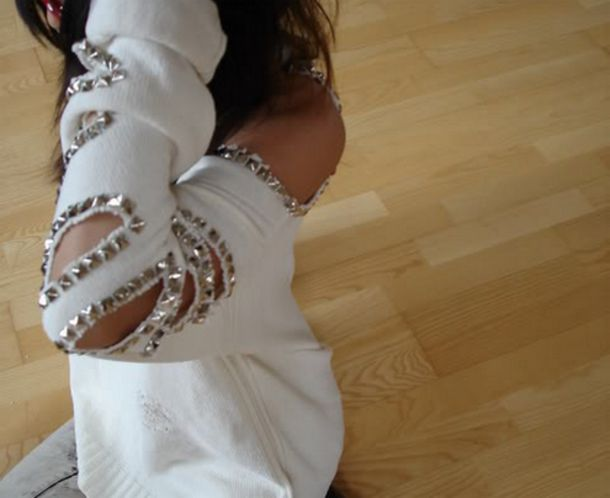 sweater studs studded white open shoulder white sweater off the shoulder sweater slits slit sleeves silver studs white sweater with silver studs shirt clothings clothes