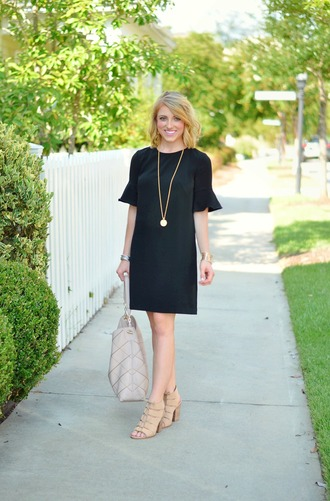 something delightful blogger dress jewels shoes black dress statement necklace mini dress white bag stacked wood heels ruffle ruffle dress necklace jewelry sandals sandal heels high heel sandals thick heel block heels