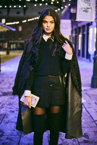skirt nyfw 2017 fashion week 2017 fashion week streetstyle black coat mini skirt black skirt asymmetrical asymmetrical skirt leather skirt black leather skirt top black top tights boots black boots over the knee boots over the knee 00s style