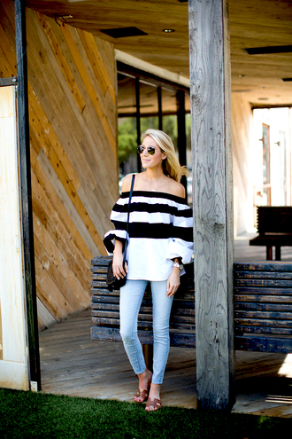 krystal schlegel blogger blouse bag jeans top dress striped off shoulder top stripes striped top long sleeves puffed sleeves off the shoulder off the shoulder top black bag shoulder bag blue jeans aviator sunglasses hermes hermes shoes slide shoes brown shoes spring outfits