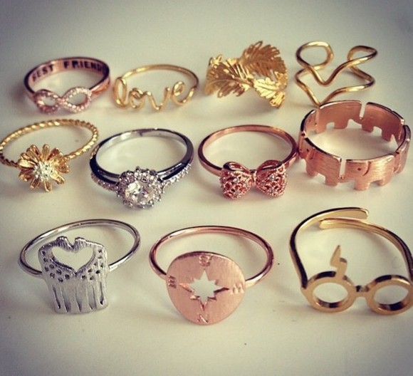jewels feathers ring flowers jewelry gold jewelry hipsters jewelry fashion jewelry rings the bling ring rings and tings gold rings silver rings bronze ring bows diamond stars love more sunglasses swag swagger cool girl style