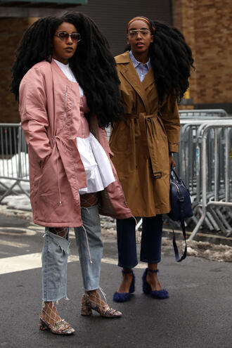 coat nyfw 2017 fashion week 2017 fashion week streetstyle trench coat pink coat camel camel coat shirt white shirt denim jeans blue jeans ripped jeans net tights tights fishnet tights shoes floral floral shoes bag blue bag