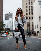sweater,knitted sweater,black pants,faux leather,skinny pants,pumps,high heel pumps,handbag,sunglasses