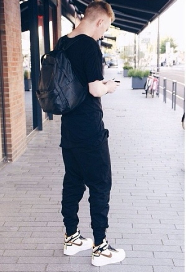 bag black dark black pants black bag leather black leather white shoes trainers black t shirt pants t-shirt ripped