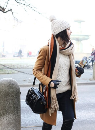 coat tumblr camel camel coat scarf striped scarf sweater white sweater cable knit white cable knit sweater jeans black jeans boots black boots over the knee boots bag black bag leather gloves gloves beanie pom pom beanie winter outfits winter look