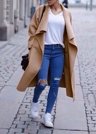 beige coat jeans jacket classy tote bag camel coat bag ripped jeans nike shoes beige coat long coat long oversized cocoon coat large coat top fashionista white shoes blue jeans denim light blue jeans light blue skinny jeans sunglasses sunnies winter outfits hipster cute style trendy cool blogger instagram clothes on point clothing cardigan outfit made waterfall coat waterfall jacket trench coat khaki wool coat fashion
