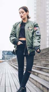 jacket,jeans,black jeans,ripped jeans,grunge,bomber jacket,urban,black crop top,satin bomber,green bomber jacket,black boots,ankle boots,black ankle boots,crop tops,skinny jeans,olive green bomber jacket