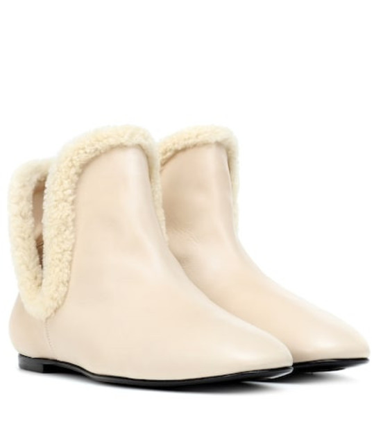 The Row Eros leather ankle boots in beige / beige