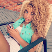 jacket,Jadah Doll hair,jadah doll,hairstyles,curly hair,blonde hair,necklace,statement necklace,top,crop tops,white crop tops,short shorts,shorts,white shorts,summer outfits,denim vest,vest,blue vest,celebrity,blue jacket,Jadah Doll nails