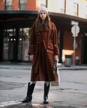 shoes,patent boots,cowboy boots,black boots,brown coat,white jeans,bag,striped top,turtleneck,knit,hat