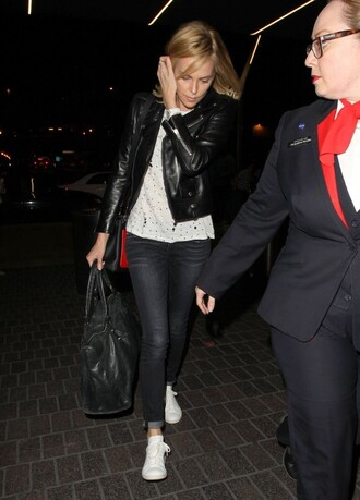 leather jacket charlize theron sneakers jeans