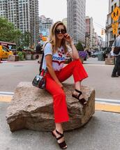 take aim,blogger,pants,t-shirt,shoes,sunglasses,sandals,red pants,summer outfits,flats,transparent  bag