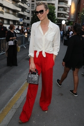 pants,karlie kloss,red pants,blouse,bag,sunglasses,wide-leg pants,sandals,flats,flat sandals,shoes,summer outfits,summer