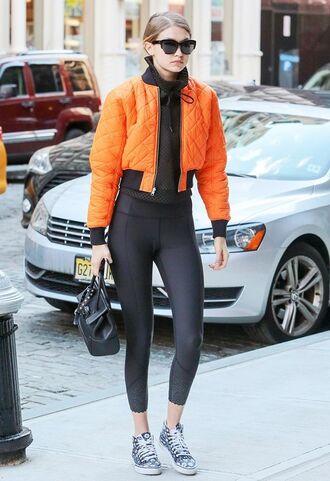 jacket orange bomber jacket black hoodie black leggings grey sneakers blogger sunglasses