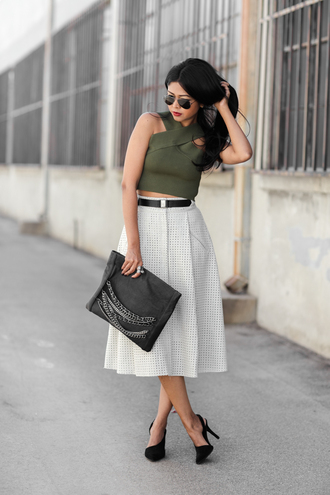 blogger khaki top bag crop tops jewels walk in wonderland pouch chain midi skirt net black heels